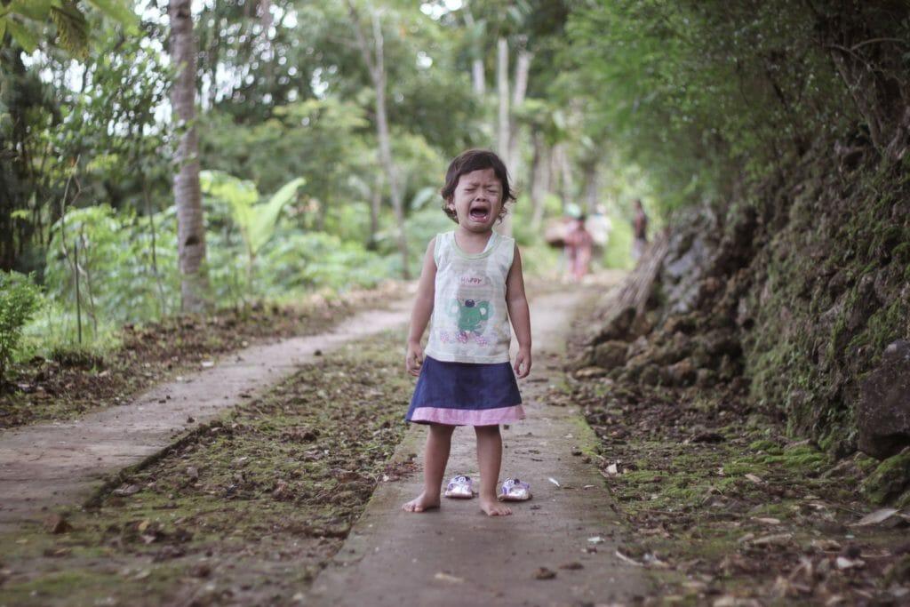 toddler girl wears white tank top
