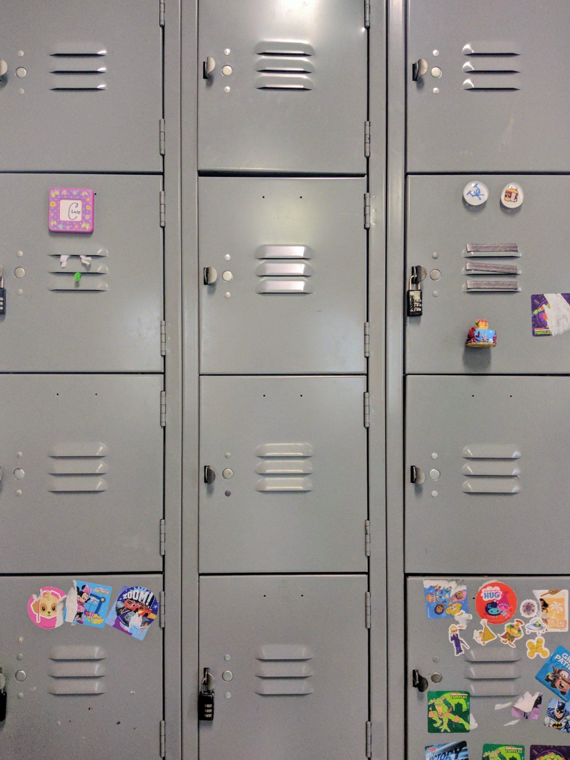 gray steel locker with stickers