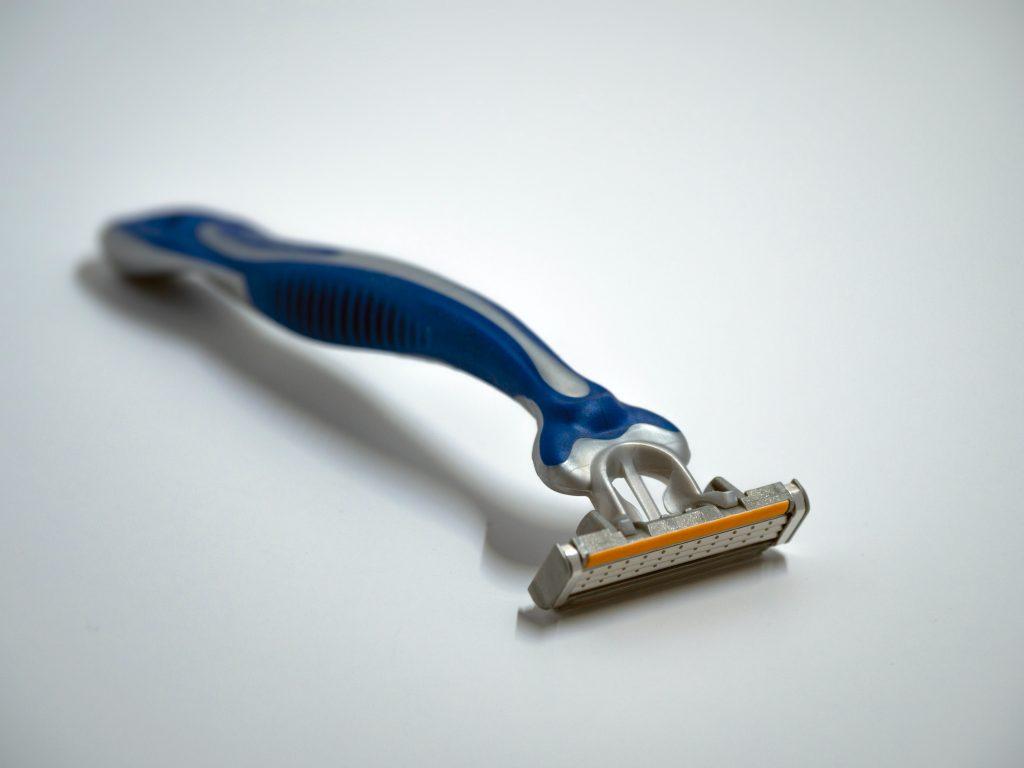 blue and silver Gillette razor
